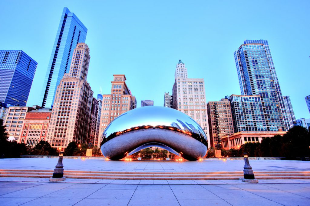 Cloud Gate in Millennium Park on September 3, 2015 in Chicago. The Cloud Gate is a major tourist attraction and a gate to traditional Chicago Jazz Fest (September 3 - 6 2015).