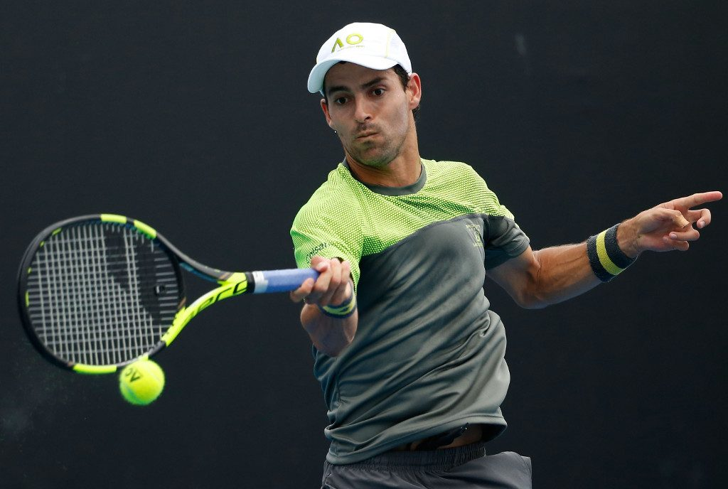 JANUARY 17: Santiago Giraldo of Colombia plays a forehand during his first round match against Kyle Edmund of Great Britain on day two of the 2017 Australian Open at Melbourne Park on January 17, 2017 in Melbourne, Australia.