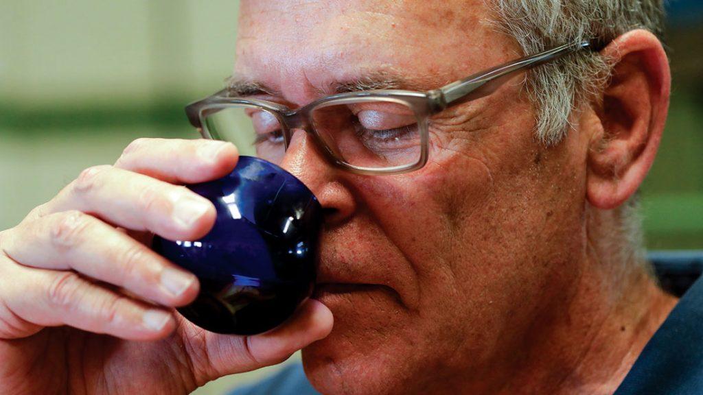João Gomes smelling olive oil during the taste