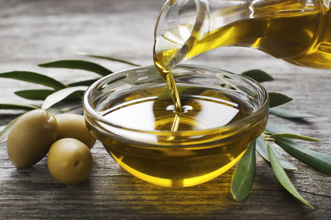 Close up Olive Oil in a glass bowl