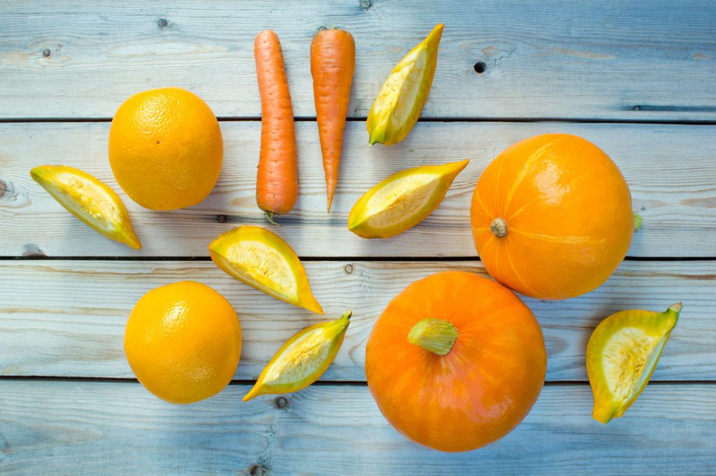 Sliced pumpkin pieces, oranges and carrots.
