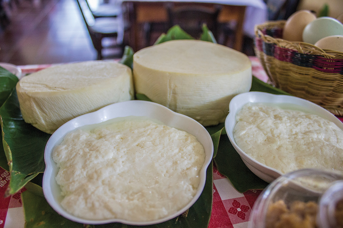 Close-Up Of Cheese In Containers On Table