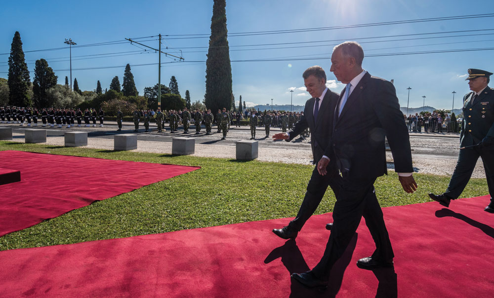 Portuguese President Marcelo Rebelo de Sousa (R) and the President of Colombia Juan Manuel Santos Calderon (L) walk together after having reviewed the Armed Forces honor formation outside Jeronimos Monastery on November 13, 2017 in Lisbon, Portugal.