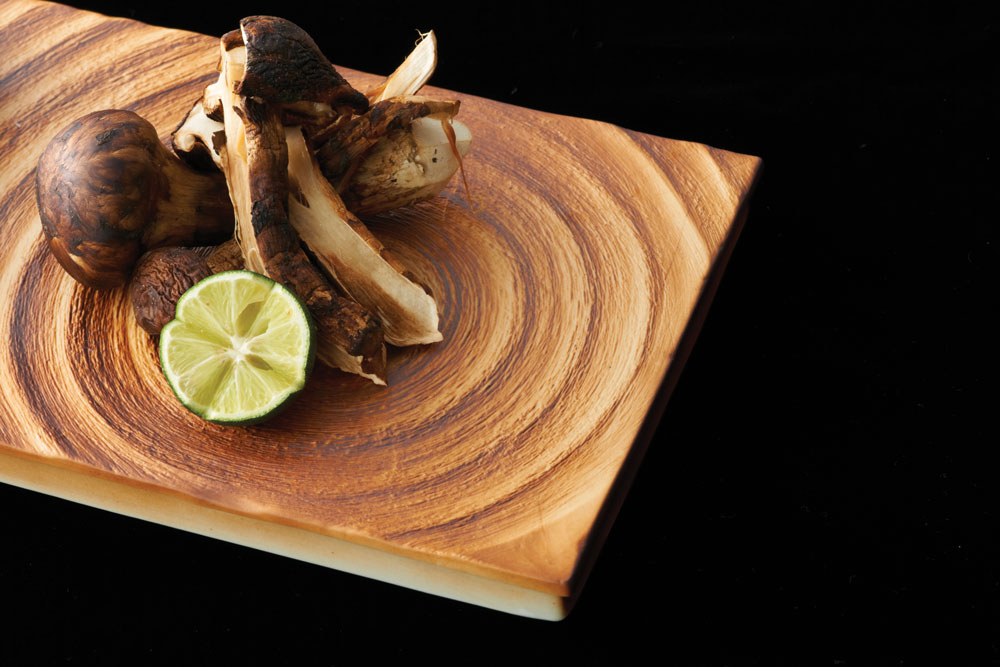 Mushrooms and lime slice on chopping board