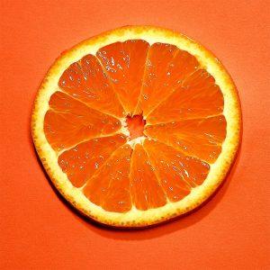 Photography slice of an orange on orange background