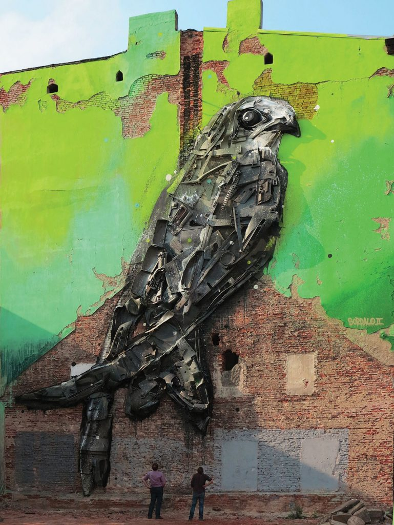 The artist's largest creation is a swallow nested on a building façade in the city of Lodz.