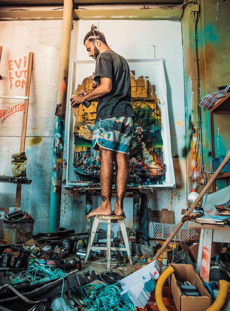 Work in progress at his studio, lab where the transformation of waste into art takes place.