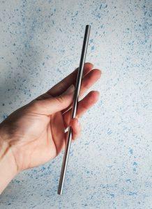 hand grabing Plastic free straws