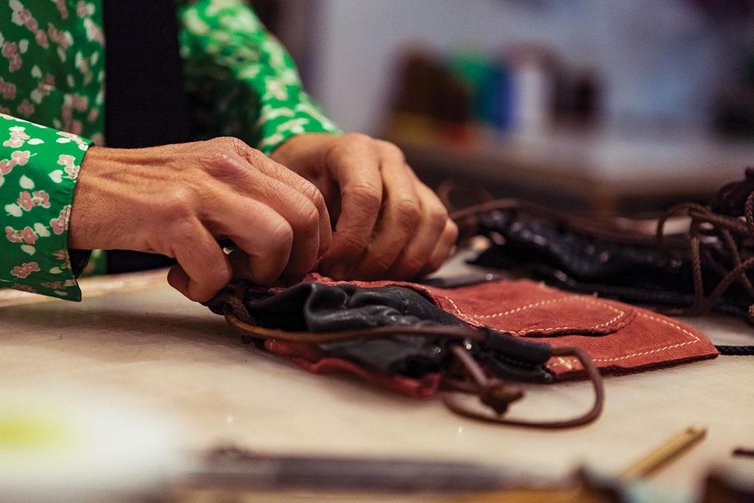 hands working on fabrics
