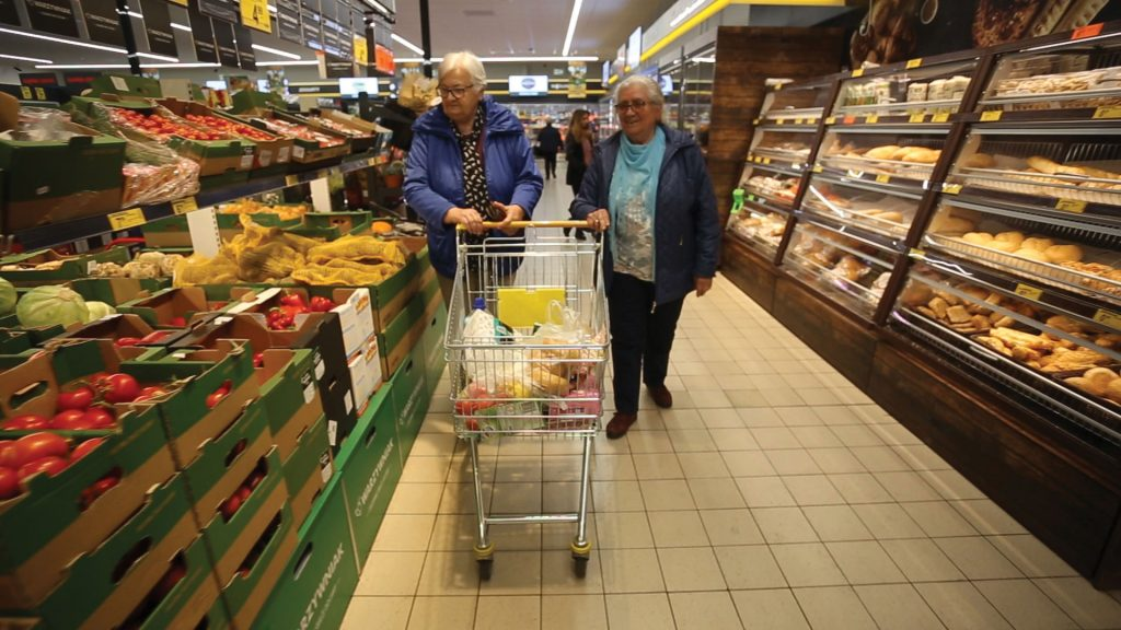 old people shopping in supermarket