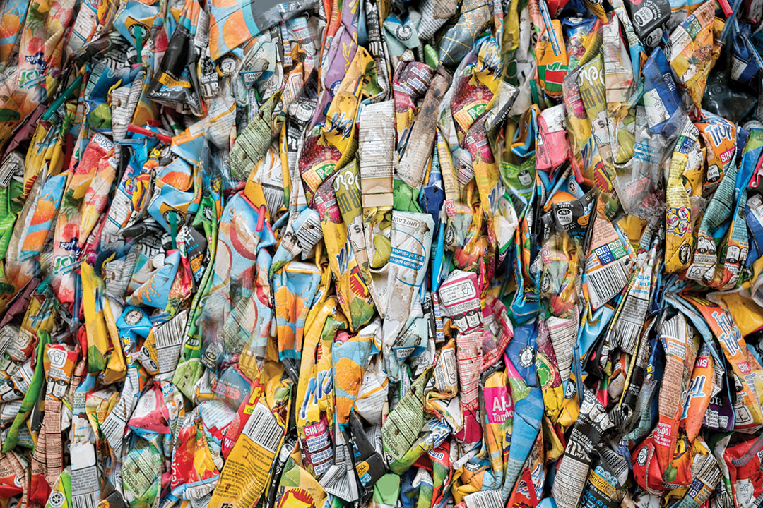 Close-up on pieces of cardboard garbage at a recycling factory - environmental concepts