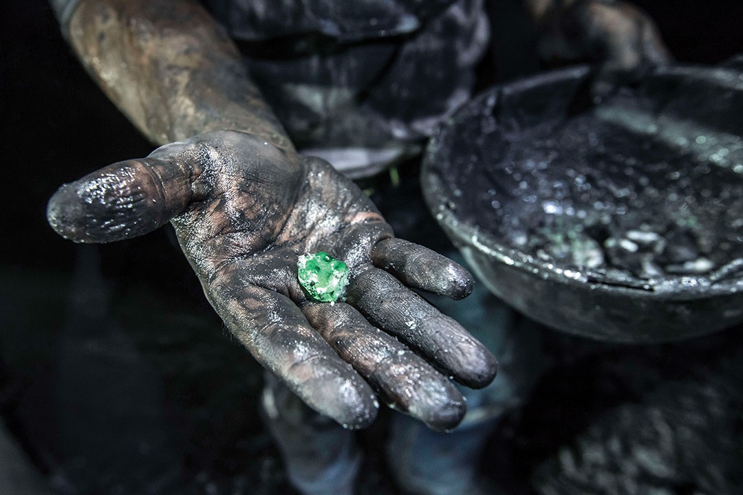 A miner shows a rough emerald extracted from Puerto Arturo pit, one of the pits of Muzo emerald mine owned and operated by American company Mineria Texas Colombia