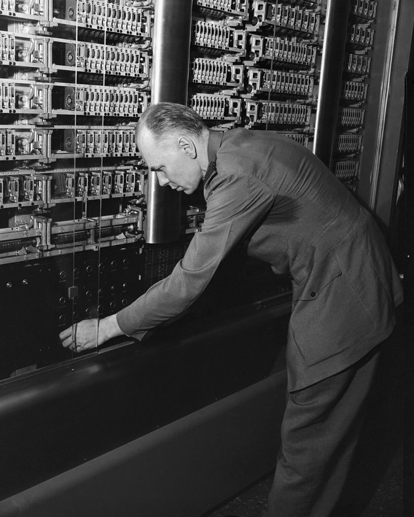 This machine, the world's greatest calculating machine will be presented to Harvard University today. Commander Howard H. Aiken, USNA, the inventor of the calculator, in the Research Laboratory of Physics at Harvard, is here tweaking the calculator.