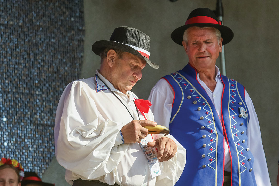 Man taking snuff from traditional Kashubian snuff box made of cow horn is seen in Chmielno, Kashubia region, Poland on 21 July 2018