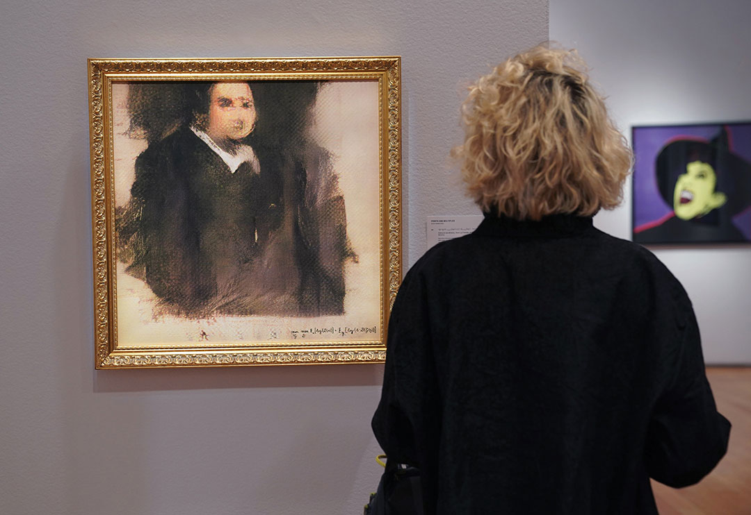 "A woman looks at a work of art created by an algorithm by French collective named OBVIOUS which produces art using artificial intelligence, titled ""Portrait of Edmond de Belamy"" (estimate: $7,000-10,000) at Christies in New York on October 22, 2018."