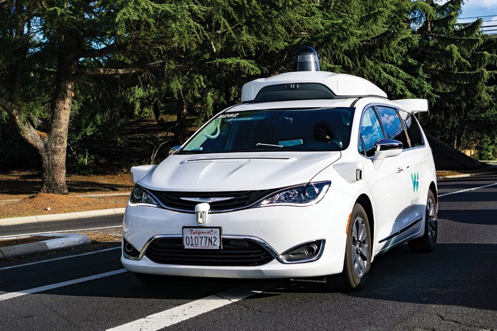 Waymo self driving car performing tests on a street near Google's headquarters, Silicon Valley - Imagem