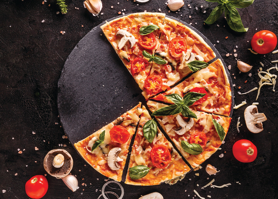 Fresh Italian pizza with mushrooms tomatoes and cheese