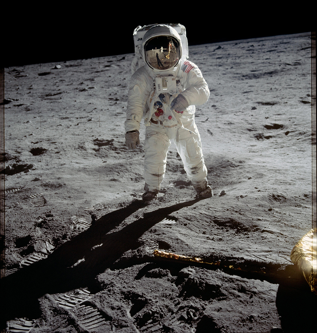 Astronaut Buzz Aldrin walks on the surface of the Moon near the leg of the lunar module Eagle during the Apollo 11 mission. Mission commander Neil Armstrong took this photograph with a 70 mm lunar surface camera, in 1969.