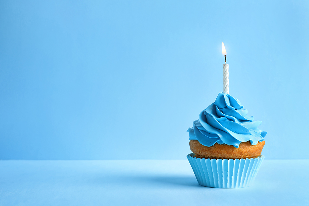 Birthday cupcake with a blue background