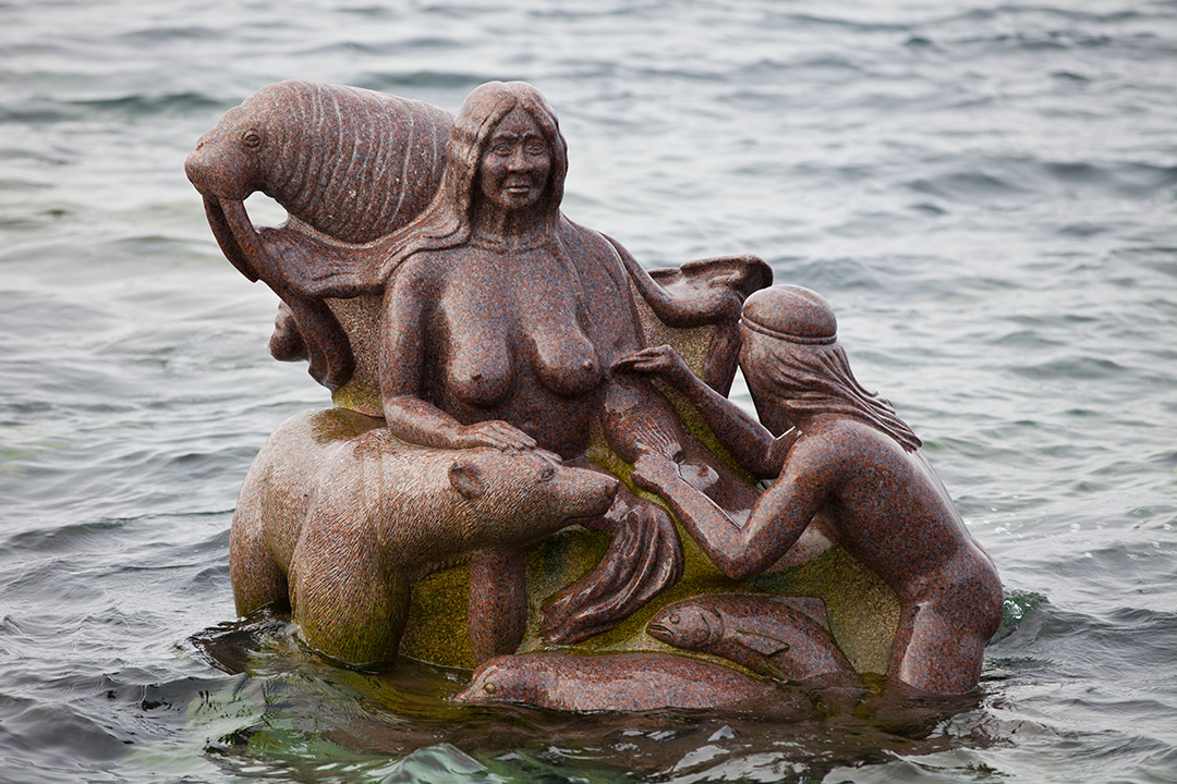 Sculpture of Sedna, the goddess of the sea in Inuit culture, at the old harbour in Nuuk, Greenland. By artist Christian 'Nuunu' Rosing.