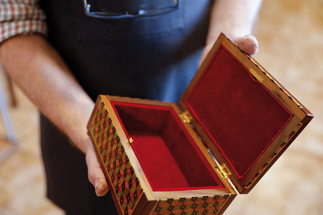 In Portuguese, these tiny compartments are called secrets, as they are made to hide precious things inside tables.