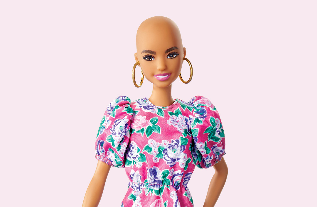 Barbie without hair on pink background