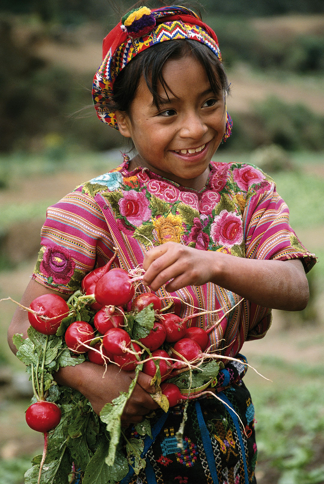 This girl is wearing a huipil, a traditional Mayan blouse, Zunil, Guatemala.