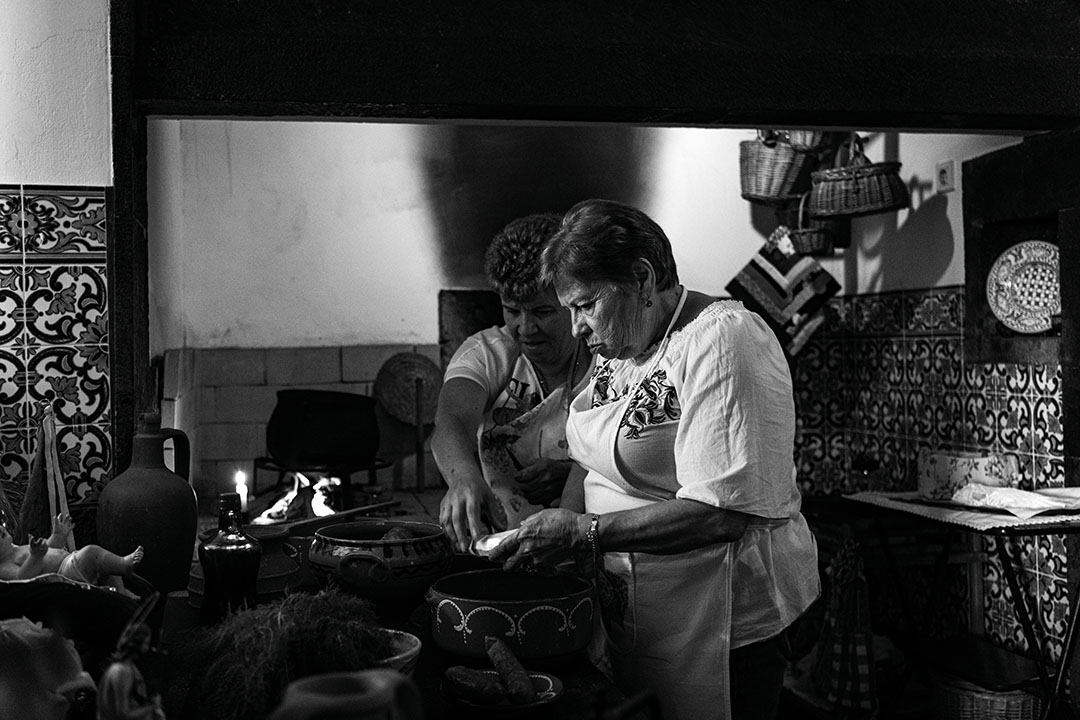 Black and white photography of Helena cooking