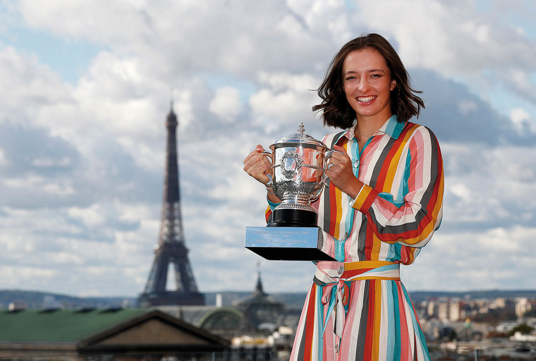 Iga Swiatek of Poland poses on the rooftop of les Galeries Lafayettes Rue de la Chaussee d'Antin with the Suzanne Lenglen Cup following her victory in the Women's Singles Final against Sofia Kenin of The United States of America on day fifteen of the 2020 French Open on October 11, 2020 in Paris, France.