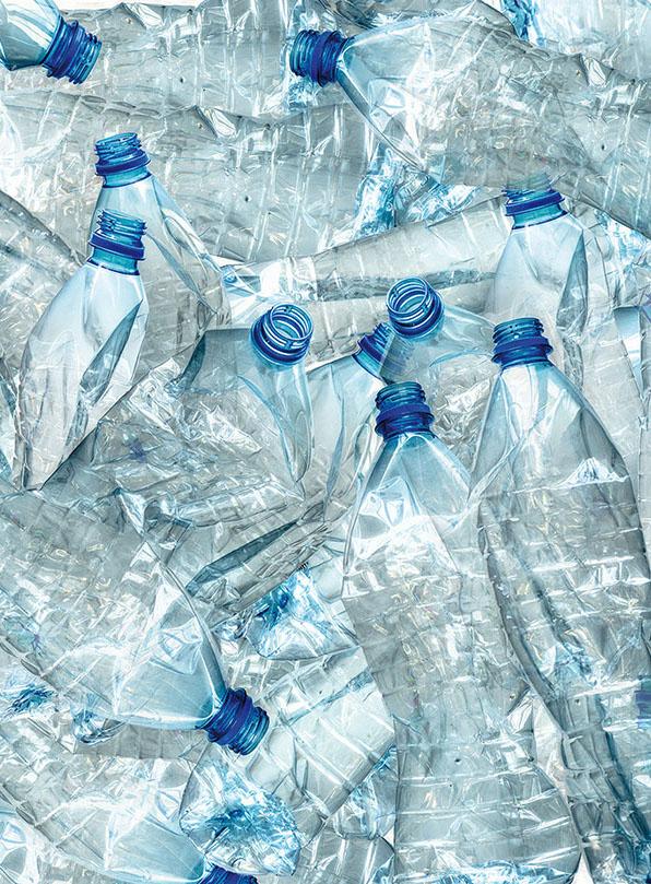 Background of many used empty PET bottles
