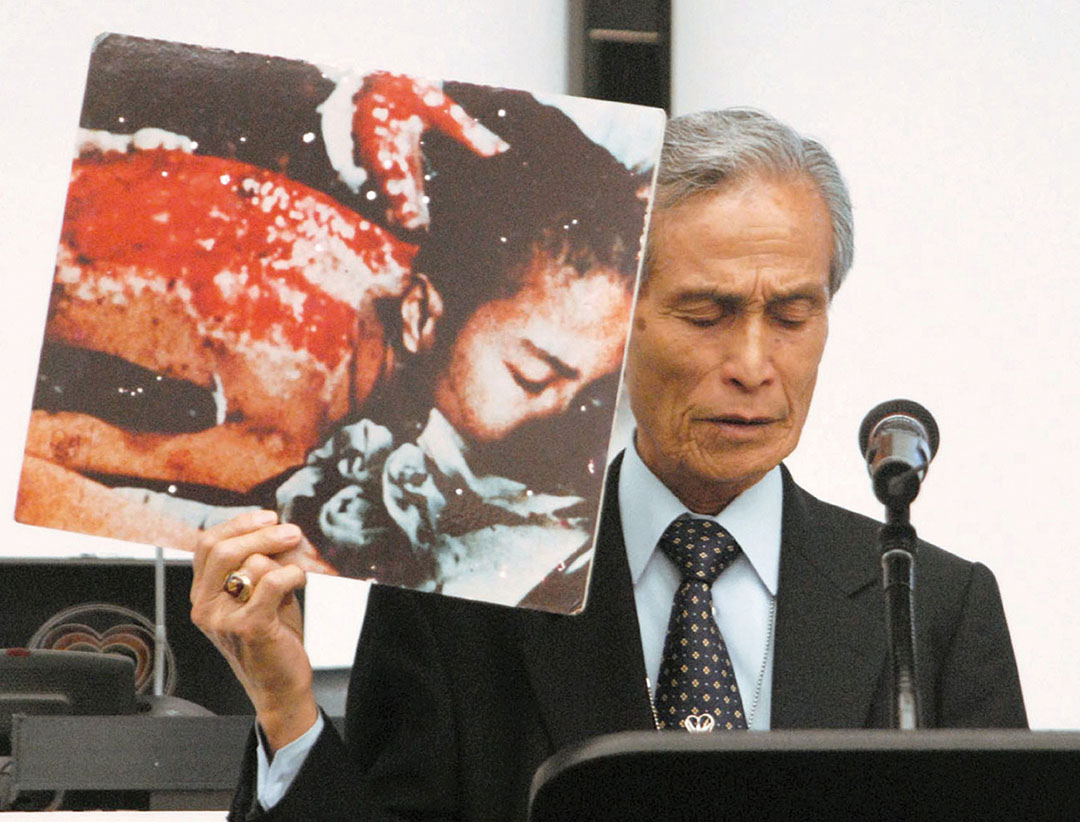 File photo taken in May 2010 shows A-bomb survivor Sumiteru Taniguchi giving a speech at the U.N. conference on reviewing the Nuclear Non-Proliferation Treaty in New York with a picture of himself suffering from severe burns caused by the U.S. atomic bombing of Nagasaki in 1945. Taniguchi died of duodenal papilla cancer on Aug. 30, 2017, at age 88. (Kyodo) ==Kyodo (Photo by Kyodo News Stills via Getty Images)