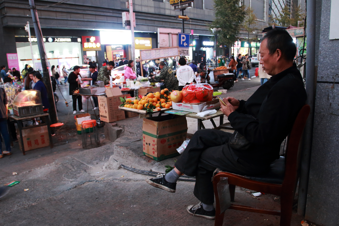 Wuhan market, China. a street seller on a busy street